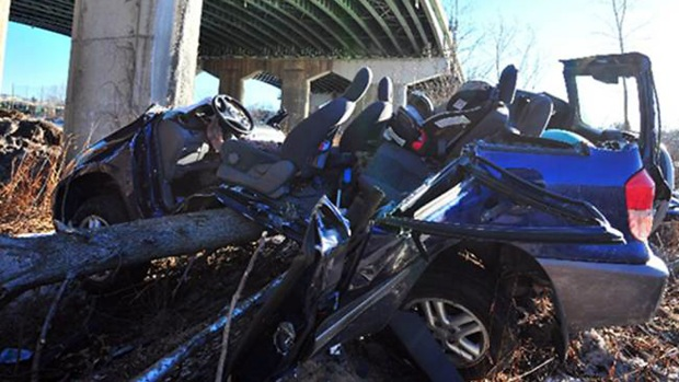 DRAMATIC PHOTOS: Firefighters Rescue 2 After SUV Falls Off Bridge