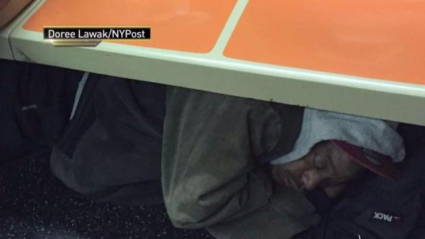 [NY] Man Sleeping Under Subway Seats Sparks Controversy