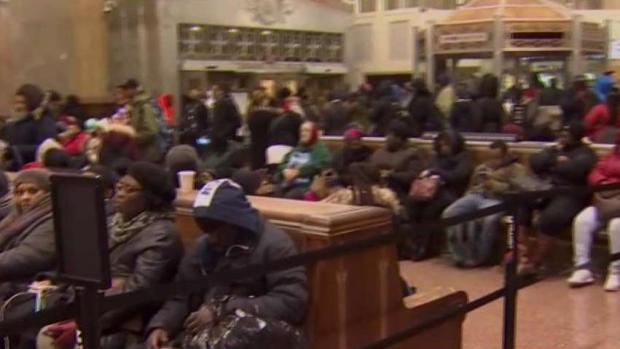 Mass Transit Commuters Wait Hours for Rides Home Amid Storm