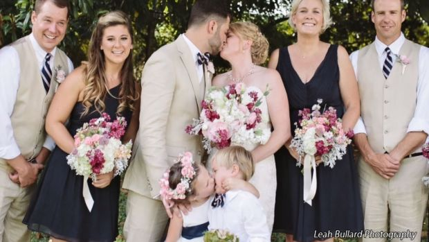Flower Girl Steals Kiss During Photo Shoot