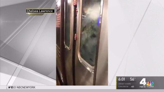 Stuck Subway Riders Desperately Try to Break Out