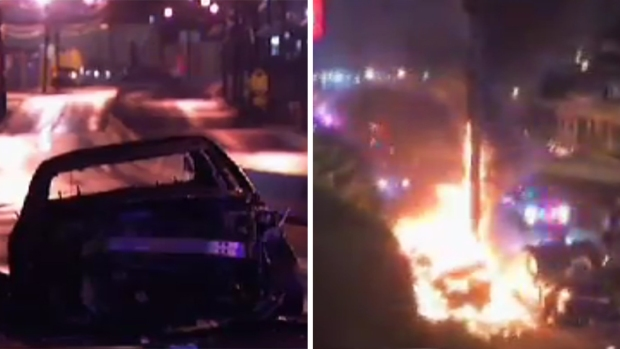 Police seen kicking burning man after chase ended in fiery crash