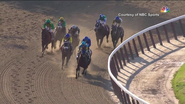 [NATL] WATCH: Crowds Cheer as American Pharoah Wins Triple Crown