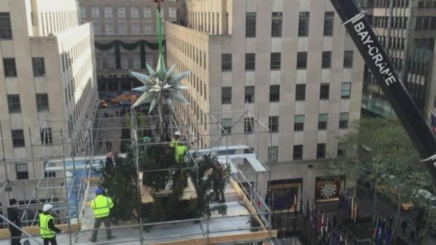 [NY] WATCH: Swarovski Star Hoisted Onto Rock Center Tree