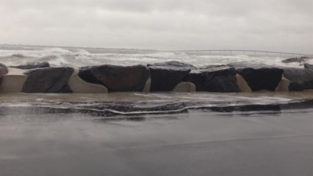 WATCH: Waves Crash Onto Street