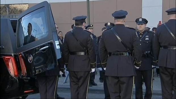 [NY] Emotional Salute as Slain Cop's Hearse Arrives for Mass