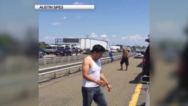 Stranded Drivers Play Football on Turnpike After Truck Fire Brings