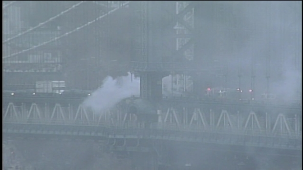 [NY] Smoke Billows From Manhattan Bridge as Flames Devour Vehicle
