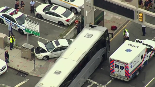 Bus and auto collide on approach to Holland Tunnel; 14 hurt