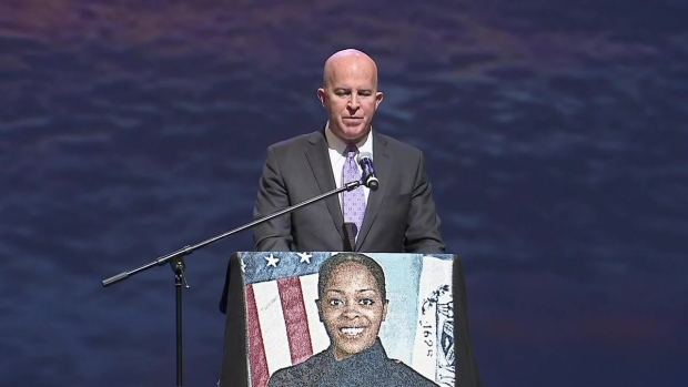 [NY]  Commissioner's Emotional Speech at Slain Cop's Funeral