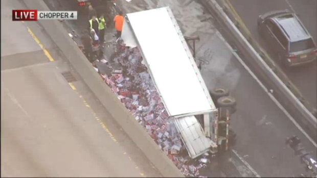 Truck carrying beer overturns on the BQE, causing major delays