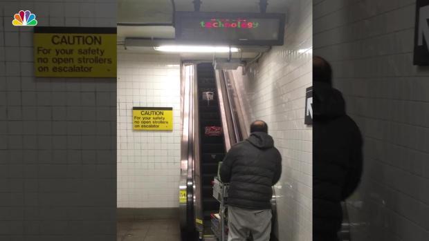 [NY] Man Has Major Struggle Getting His Beers Up Subway Escalator