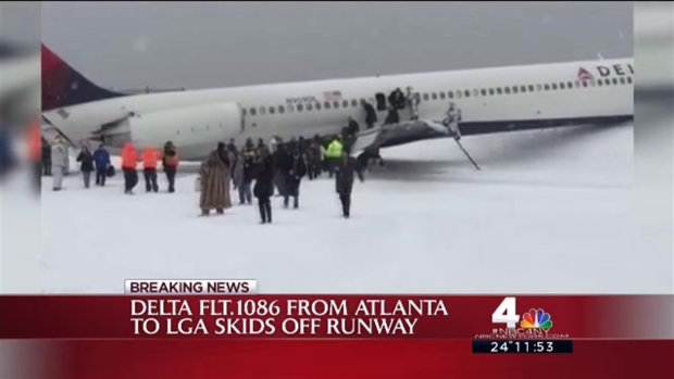 WATCH: Passengers Exit Plane That Skidded off LGA Runway