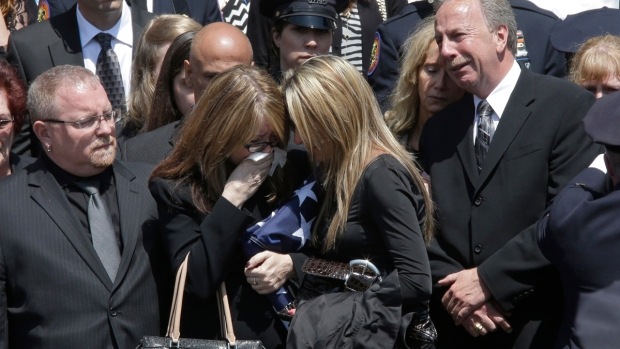 [NY] Emotion Overwhelms as Officers Hand Flag to Family of Slain NYPD Officer