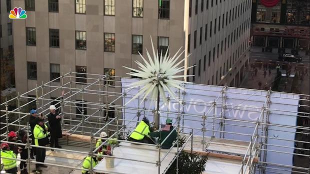 Dazzling New Swarovski Star Lowered Onto Rockefeller Christmas Tree