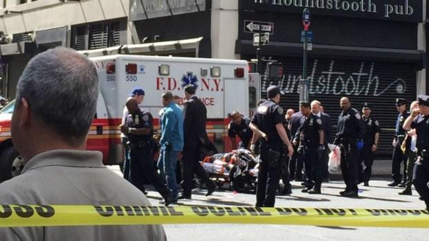 PHOTOS: Man Wielding Hammer Shot in Midtown