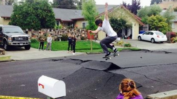 [NATL-BAY] RAW VIDEO: Skateboarders Jump Buckled Napa Streets