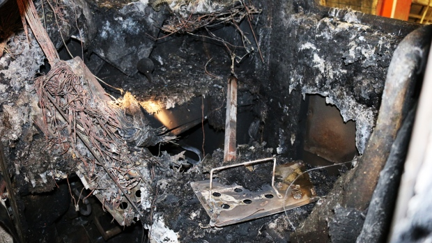 First Look: Inside the Charred Remains of Metro-North Train in Deadly Accident