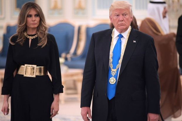 Melania appears to reject hand...again