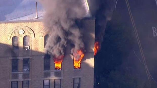 [NY] Fire Blazing at Top of Apartment Building
