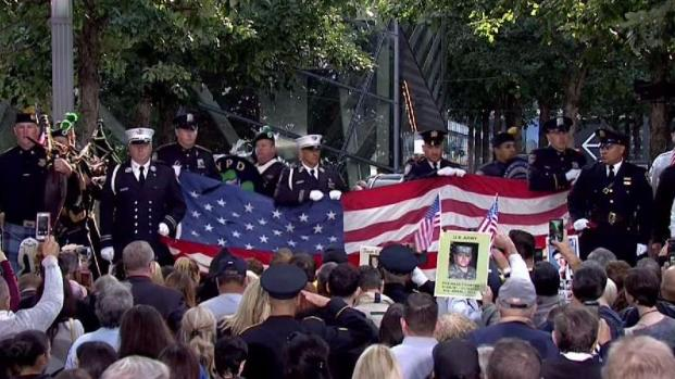 Silence, Emotion as American Flag Is Unfurled at WTC on 9/11