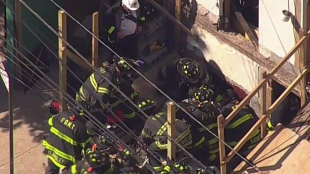 Rescue After Crane Load Drops in Astoria