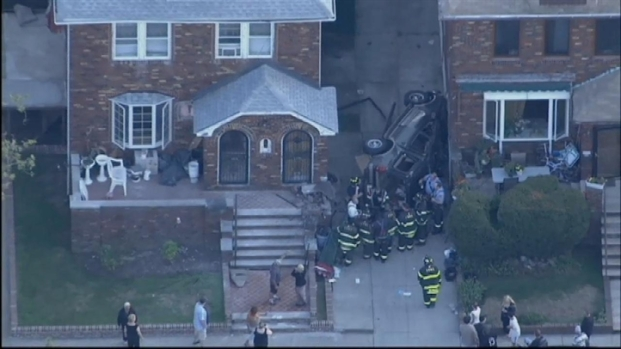 [NY] SUV Flips, Crashes Against Home in Brooklyn