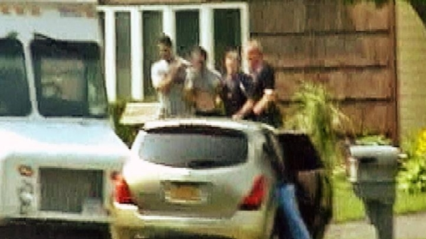[NY] Raw Video: 2 Taken From Medford Home in Handcuffs