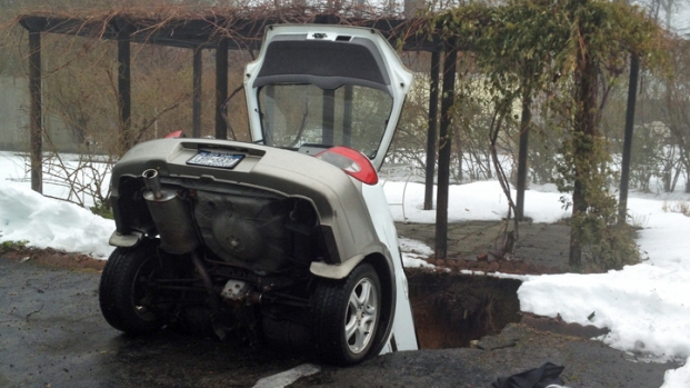PHOTOS: Car Plunges Into Sinkhole