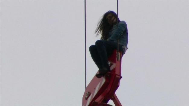 Woman Rescued From Crane Hook