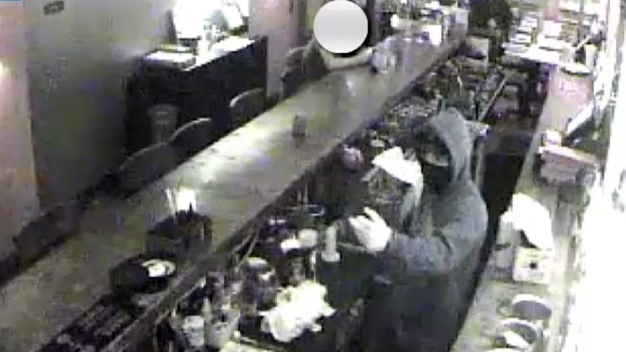 Oblivious Patron on Phone Through Machete Restaurant Heist