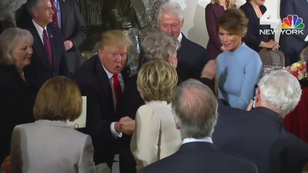 President Donald Trump Shakes Hands With Hillary Clinton