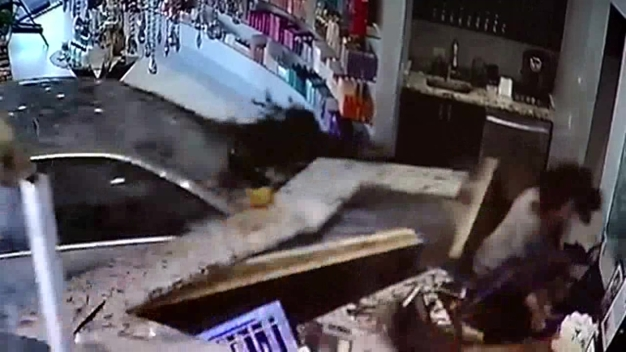 Dramatic Video Captures Car Slam Into Salon