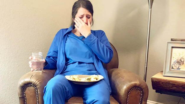 Photo Shows Emotional, Exhausted Nurse After 53-Hr Workweek}