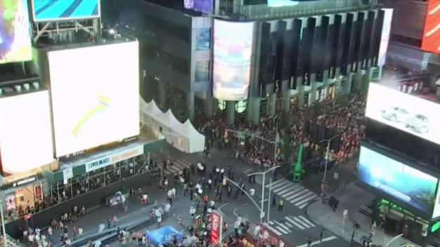 Huge Crowds Fill Times Square to Mark End of Pride Month