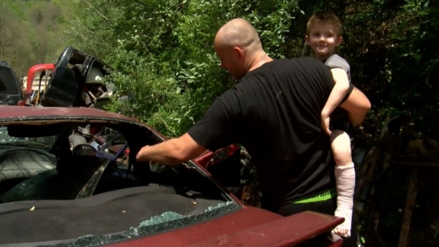 Boy Crawls Out of Wrecked Car, Finds Help to Rescue Dad