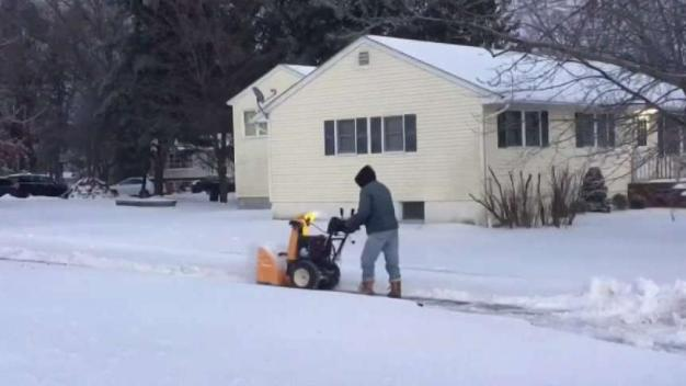 Residents Dig Out Ahead of Deep Freeze