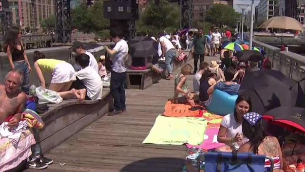 Thousands Line East River for NYC Fireworks Show