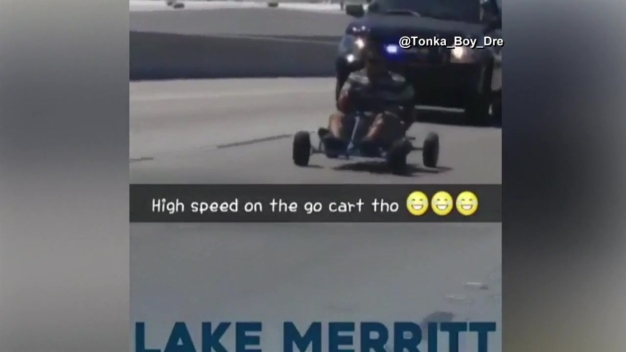 SUV With Police Lights Chases Go-Kart Down Freeway