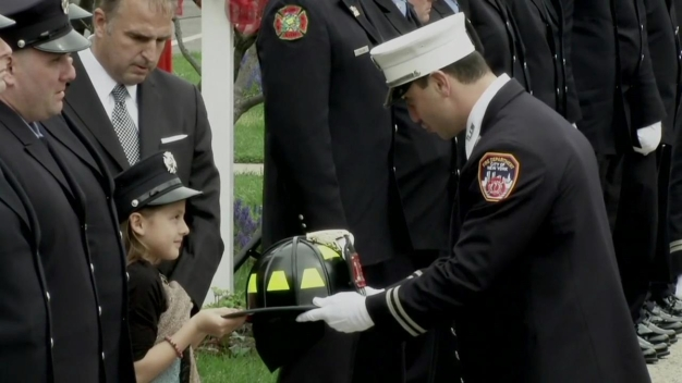 Fallen Firefighter's Helmet Passed on to 8-Year-Old Daughter
