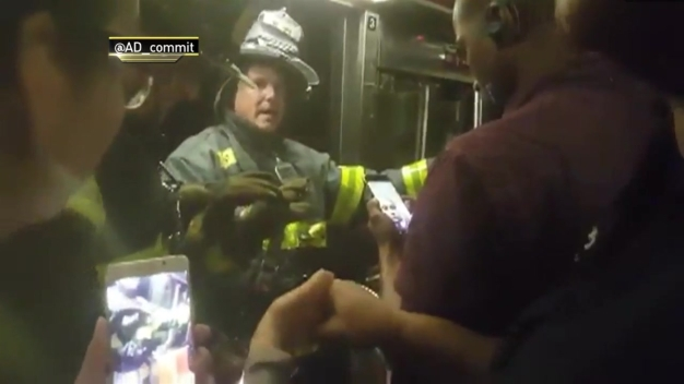 Firefighters Evacuate Passengers Trapped in Derailment