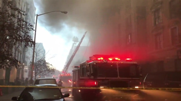 Eerie Smoke Cloud Fills Streets Amid Raging Apartment Fire