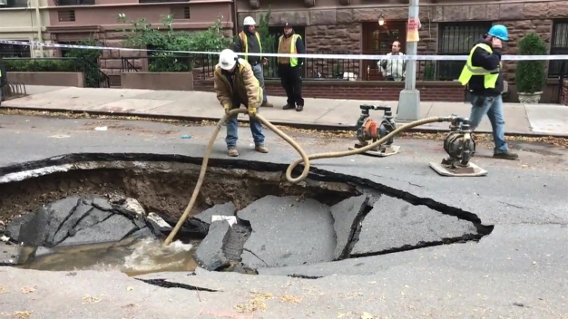 Raw Video: Gaping Sinkhole Opens on Manhattan Street