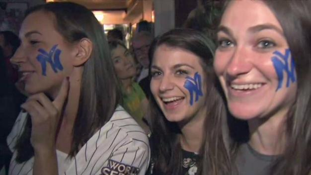 Yankees Fans Hang on to Hope in Game 7