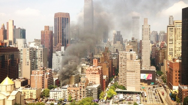 Fire Burns at Manhattan Restaurant