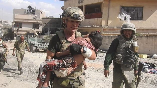 Video: Aid Worker Braves ISIS Gunfire to Rescue Little Girl