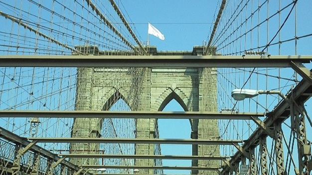 Bleached American Flags Appear Atop Brooklyn Bridge