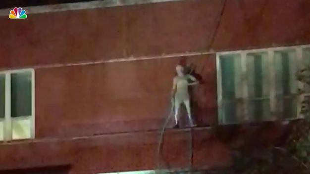Cops Try to Get Dancing, Showering Naked Man Down From NYC School Ledge