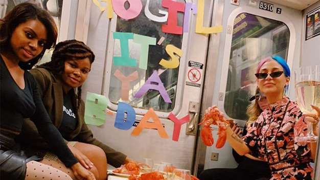 Woman Walks Into Surprise Birthday Party on Subway Train