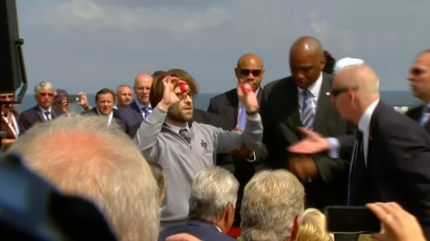 Man With Swastika-Painted Golf Balls Interrupts Trump